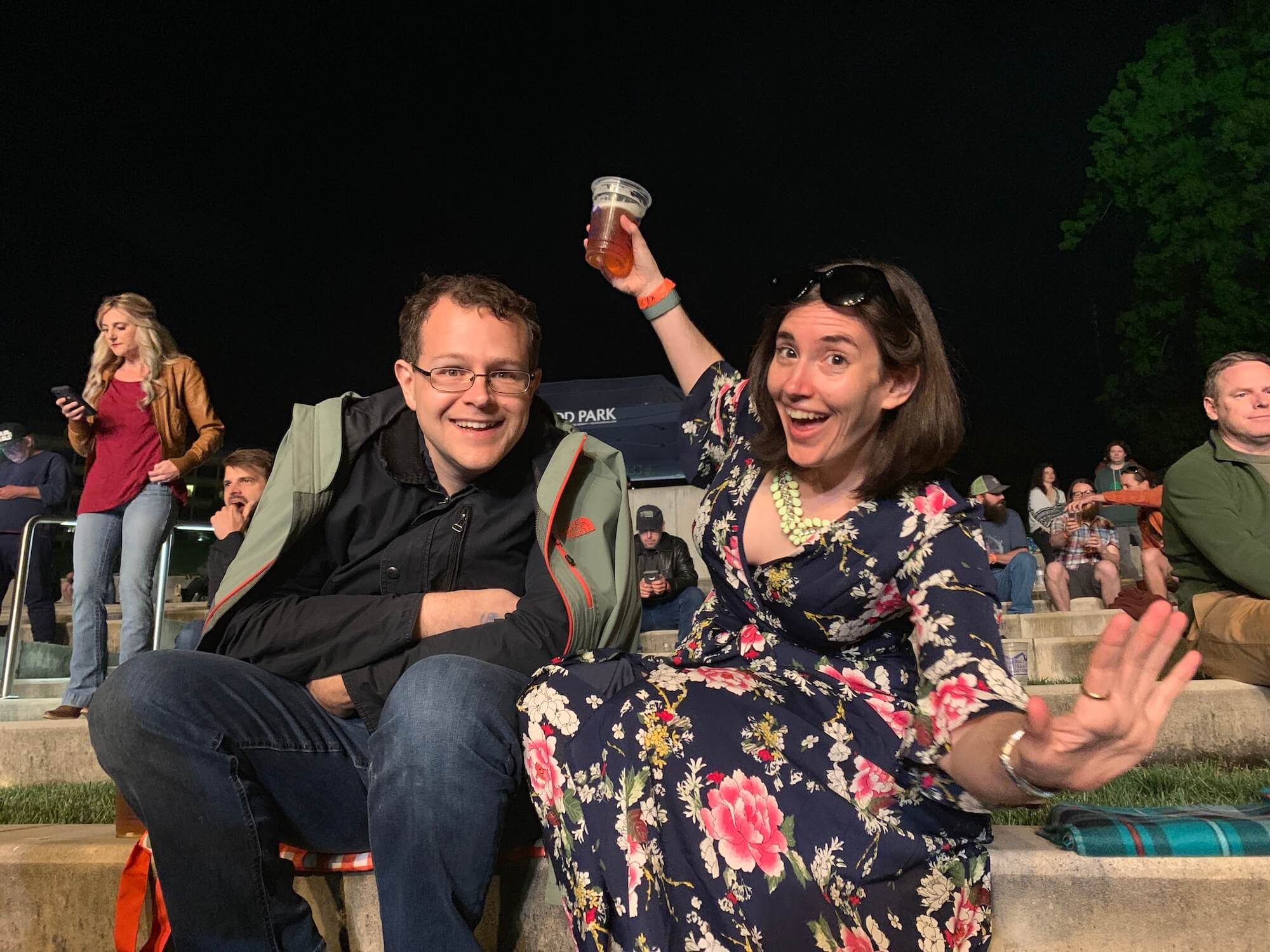 My spouse and me enjoying a concert in Elmwood Park amphitheater