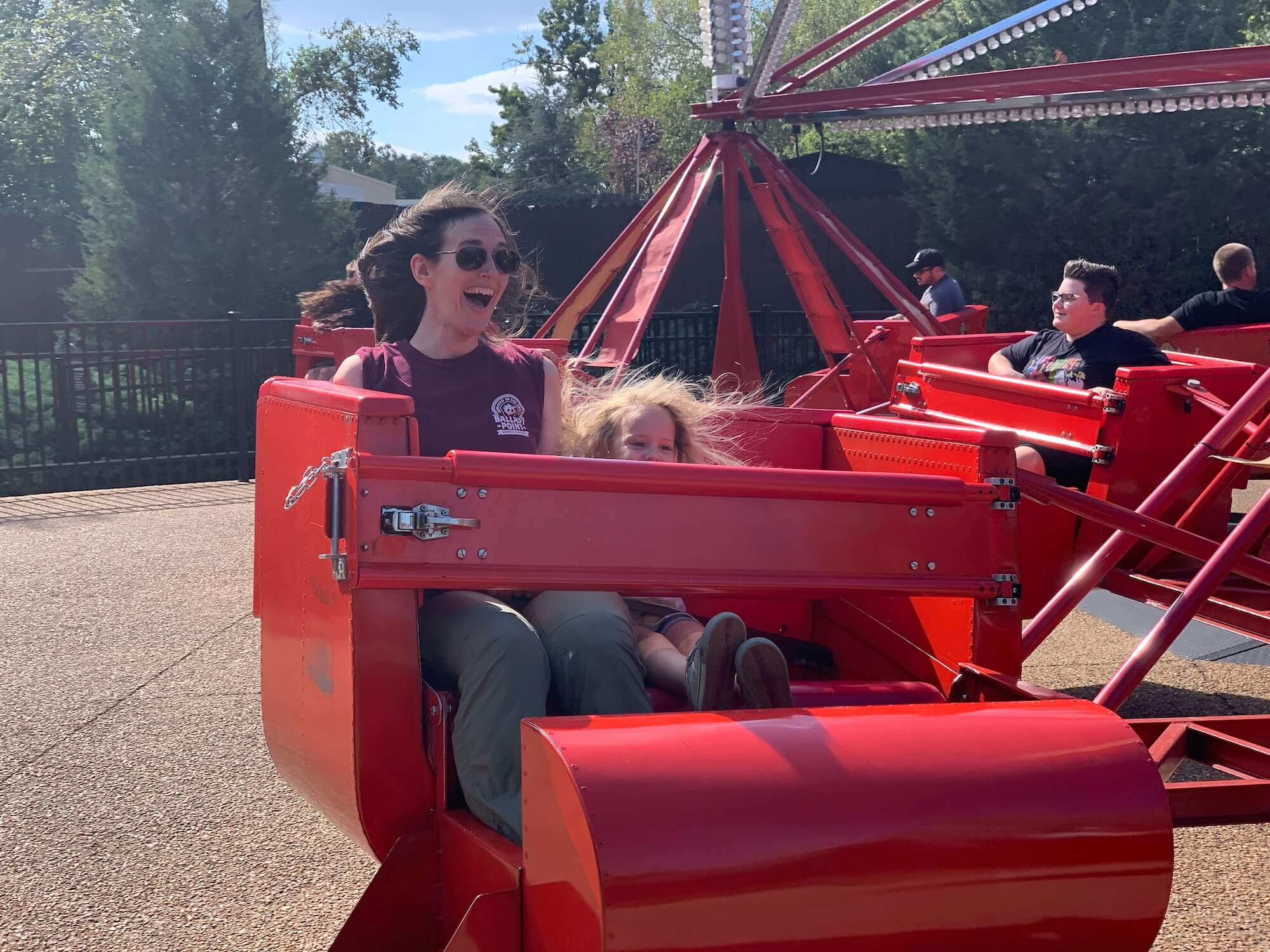 My daughter and I riding a scrambler amusement park ride