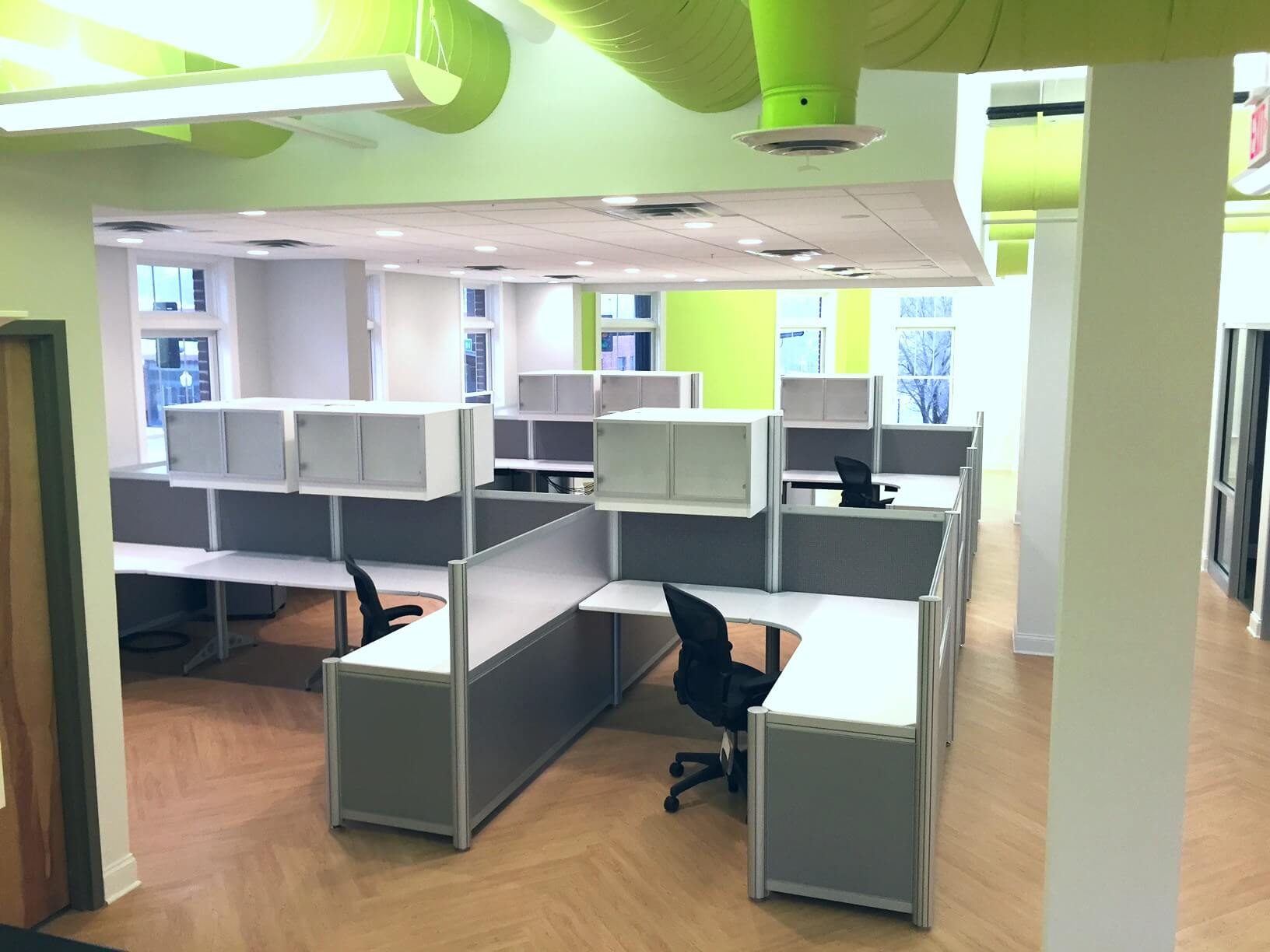 Empty desks on south side of NewCity office space looking out towards Main Street.